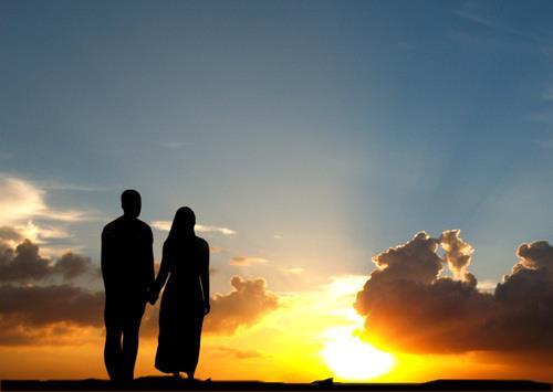 Muslim couple, sunset